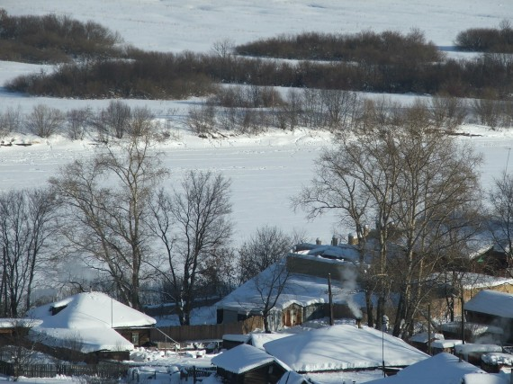 деревенские дома над рекой Вяткой